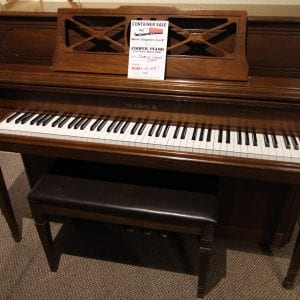 Late model piano plays great.