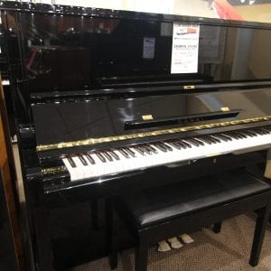 This piano looks and plays like new. Full Warranty
